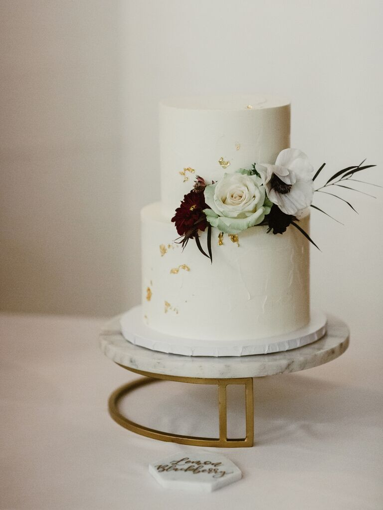 Simple wedding cake on marble cake stand