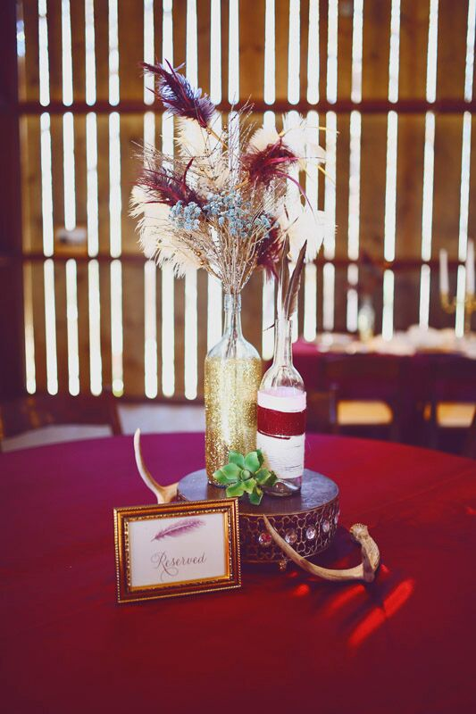 "The centerpieces were a bona fide bohemian dream. Gold-dipped vintage bottles filled with colorful feathers and dried flowers were displayed atop bejeweled pedestals and styled alongside succulents and antlers, giving each table a subtle free-spirited feel. ""We love traveling and are all about adventuring, so we wanted to do something a little nontraditional,"" Madelyn says."