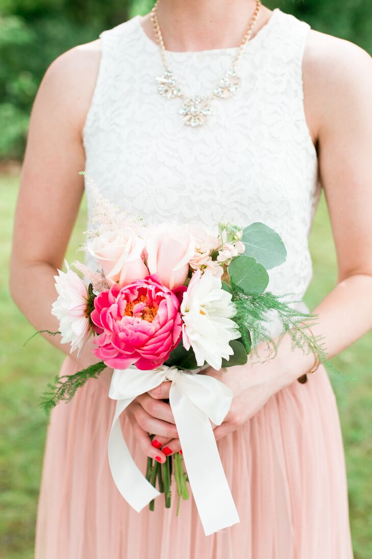 Jamie gave her bridesmaids different statement necklaces that echoed their styles and personalities. Using mismatched jewelry allowed each girl's personality to shine through without compromising the uniform look of the wedding party.