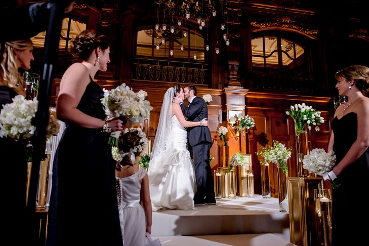Beth and Stephen were married under hanging votive candles, and the altar at which they said their vows was decorated with spilling white bouquets of delphiniums, tulips and roses.