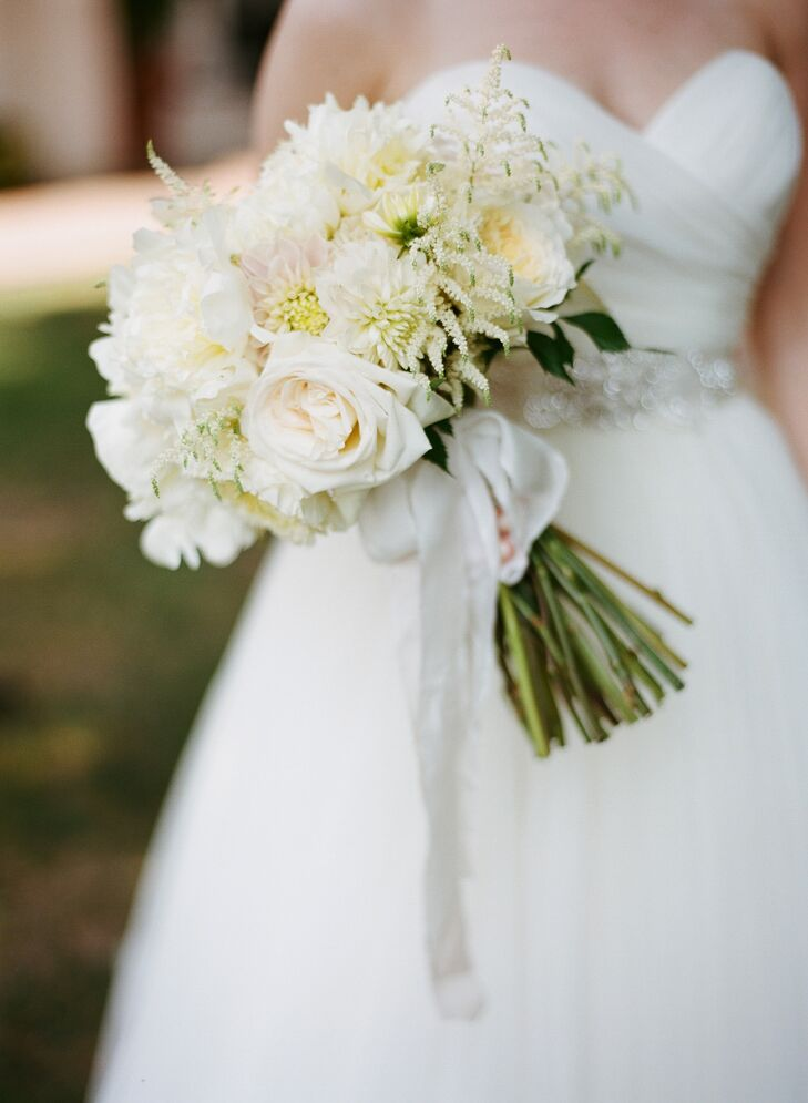 Katie carried roses, dahlias, stock and peonies in her lush white bouquet.