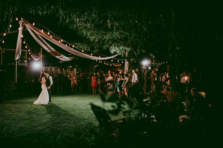 Swaths of fabric were draped high alongside string lights at the backyard reception in Okanagan, British Columbia, where the lush lawn served as the dance floor.