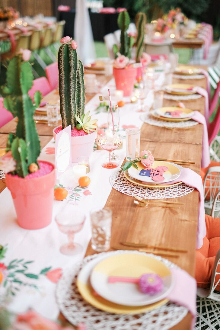 Pink-potted cacti went with the floral table runner and vibrant pink and yellow plate settings, all of which maintained a distinctive retro Palm Springs style.