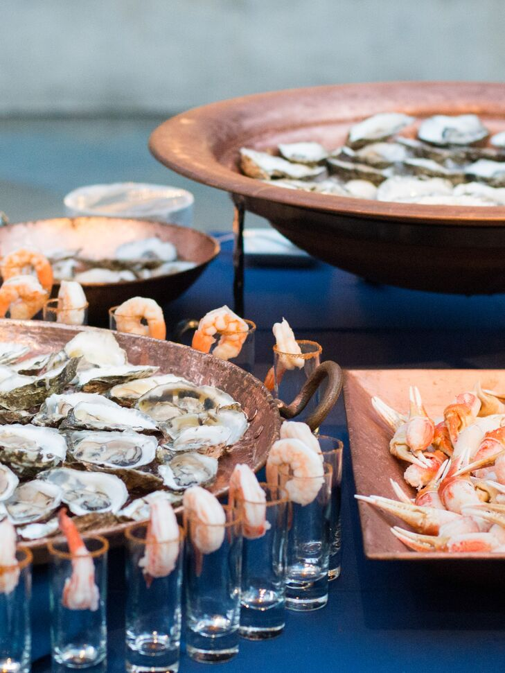 """For the cocktail hour, I wanted to have a large sampling of seafood in a raw bar—crab claws, oysters, shrimp—as well as a good selection of meats—duck, beef, pork,"" Kathryn says. For dinner, the couple had various food stations so there would be more time for dancing and drinking for the actual party."