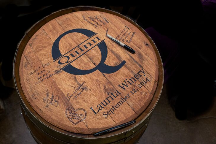 Rachel and Robert skipped the traditional guest book and instead had their guests write their names and well wishes on a personalized wine barrel, fitting of the wedding's locale.