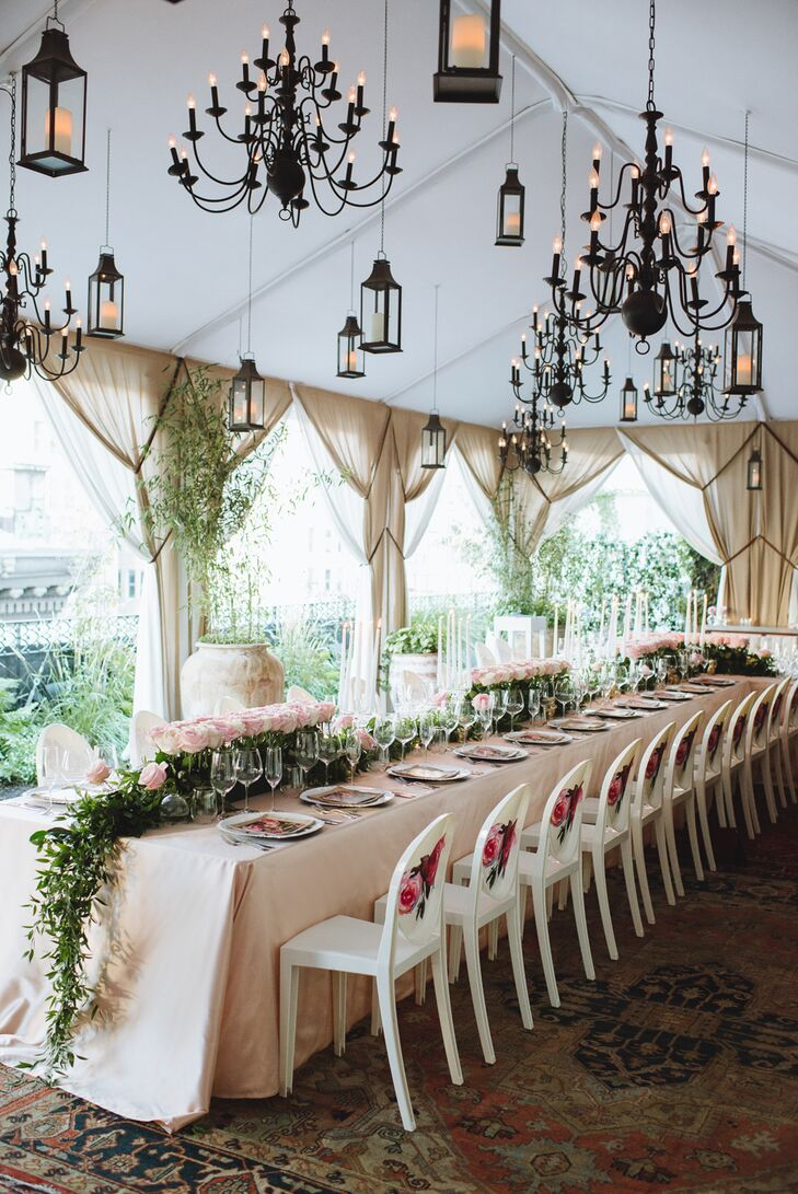 A small guest list enabled Whitney and Ryan to seat all their friends and family members around a single long table, creating the feel of an intimate family dinner. Hanging overhead were dozens of carriage lanterns and intricate candelabras that lent a note of whimsy and extravagance to the setting as the sun began to set over the city skyline.