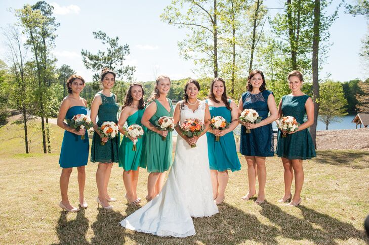Colleen's bridesmaids each picked out their own blue or green short bridesmaid dresses. Matching gold bracelets and nude shoes completed the cheery look.