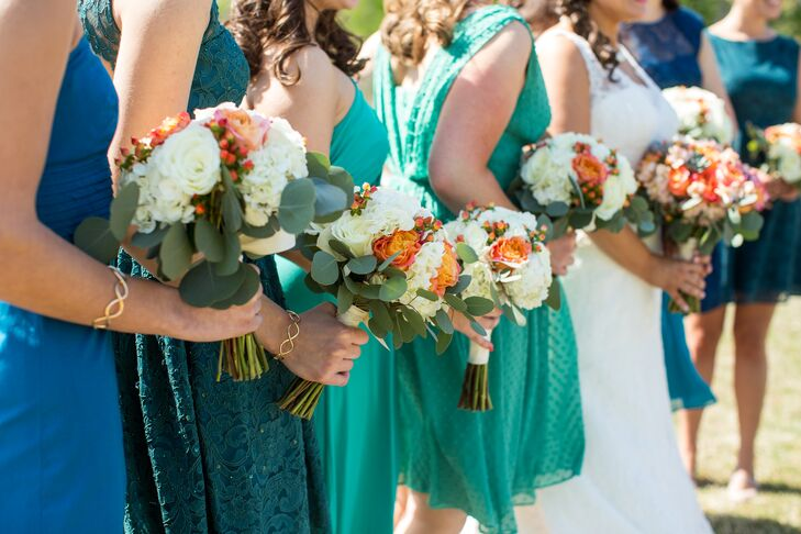 """The """"rustic elegance"""" theme was inspired by Colleen and Sean's passion for the outdoors as well as their love of wood and stone. For their springtime color palette, Colleen worked with all of her favorite colors—teal, peach and gold—for a simple-yet-elegant feel.rn"""