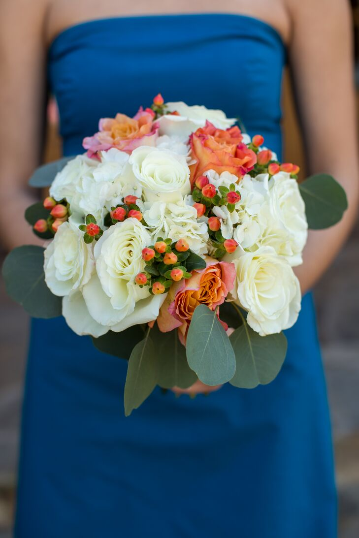 The bridemaids' bouquets included hydrangea, roses, spray roses, hypericum berries and seeded eucalyptus.