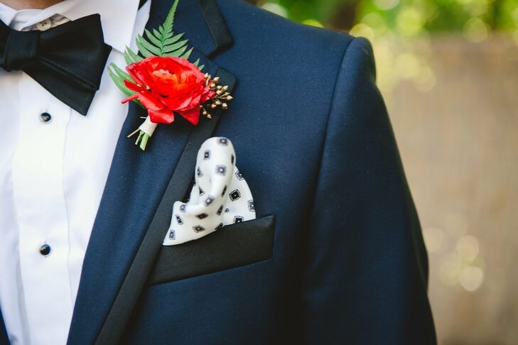 A bright red ranunculus added a fresh pop of color to Michael's look.