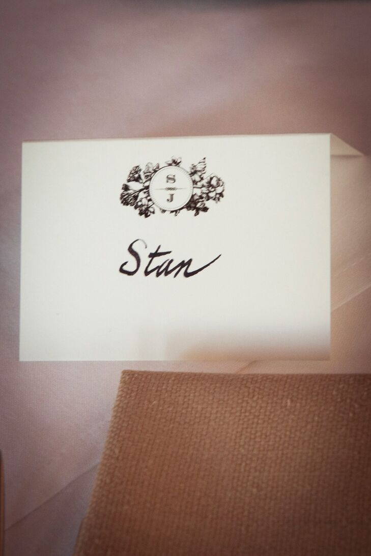 To fit the classic-meets-contemporary vibe, Stanley and Jason chose a simple, elegant design to carry throughout the evening. While the menus boasted an understated, modern aesthetic, the place cards featured a floral monogram with a hand-drawn feel, with each guest's name handwritten in black ink.