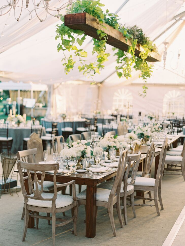 Vintage Wood Farm Tables and Mismatched Chairs at Tented Reception
