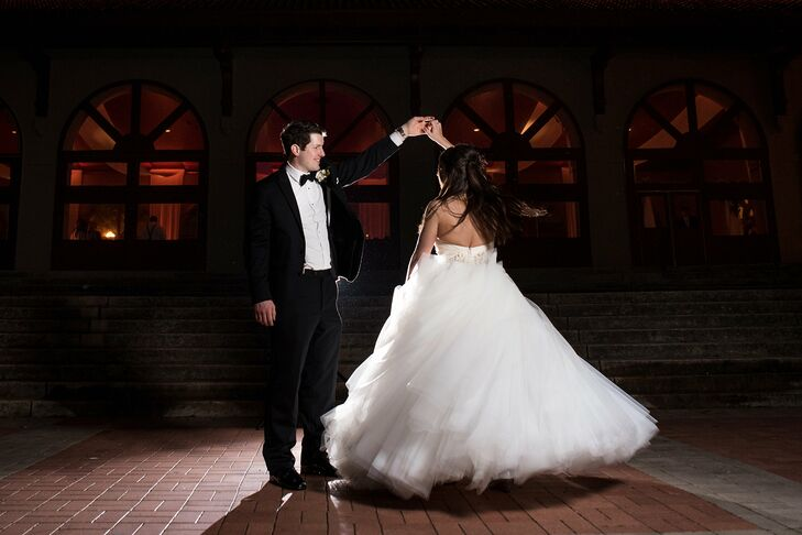 Kathleen wore an ivory Lazaro ball gown with a silk sweetheart neckline, tulle skirt and beaded belt. She loved the full silhouette and how it flowed around her. She completed her look with her hair in a half-up hairstyle and a necklace from Alan.