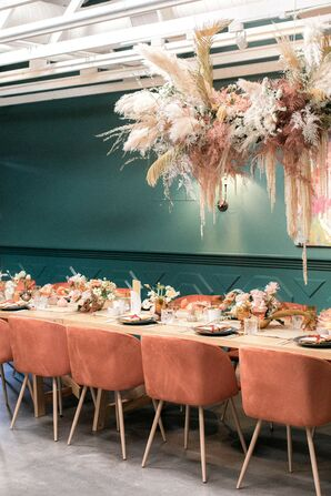 Bohemian Reception with Coral Chairs and Hanging Decorations