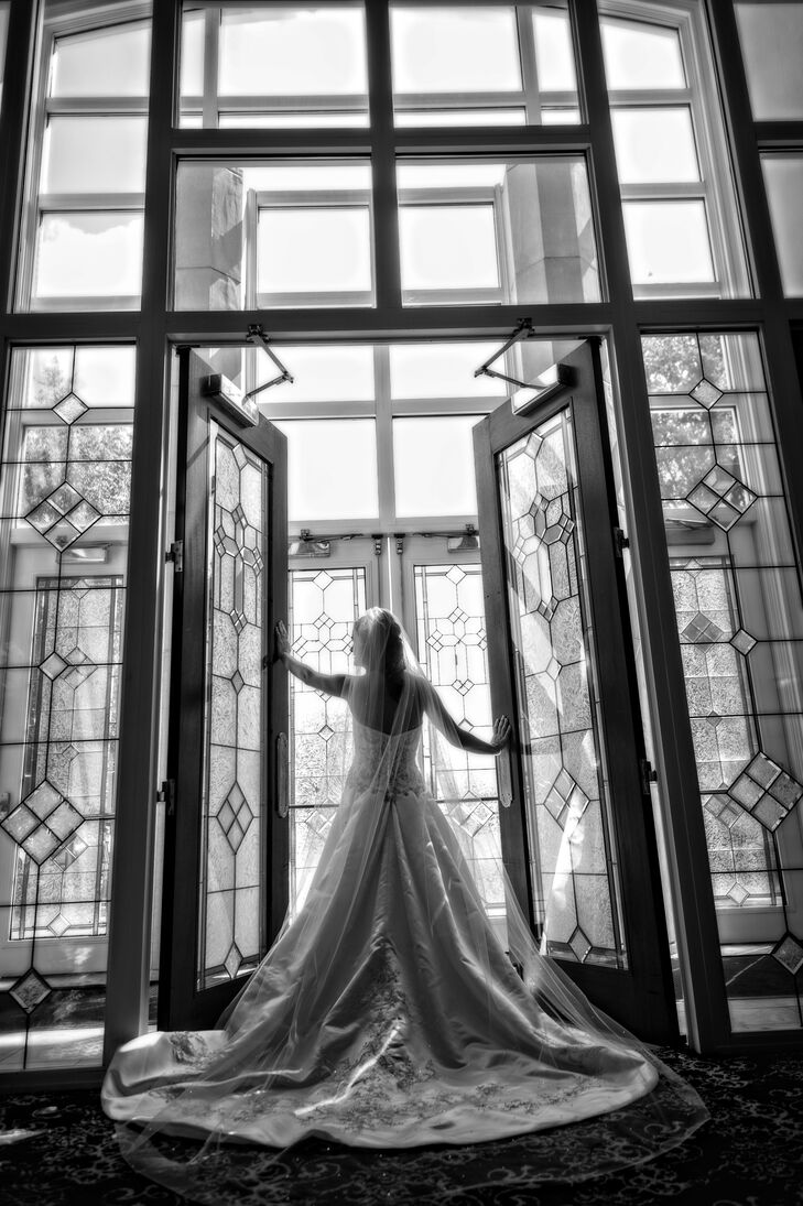 """""""My wedding dress is the perfect cross between a ballgown and an A-line dress,"""" says Leslie. """"It was diamond white satin and heavily beaded with silver thread and a sweetheart neckline."""""""