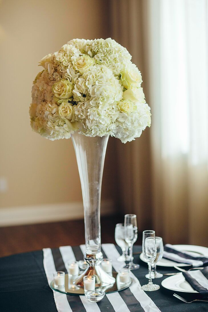 Tall Clear Centerpiece with white Hydrangeas and Roses