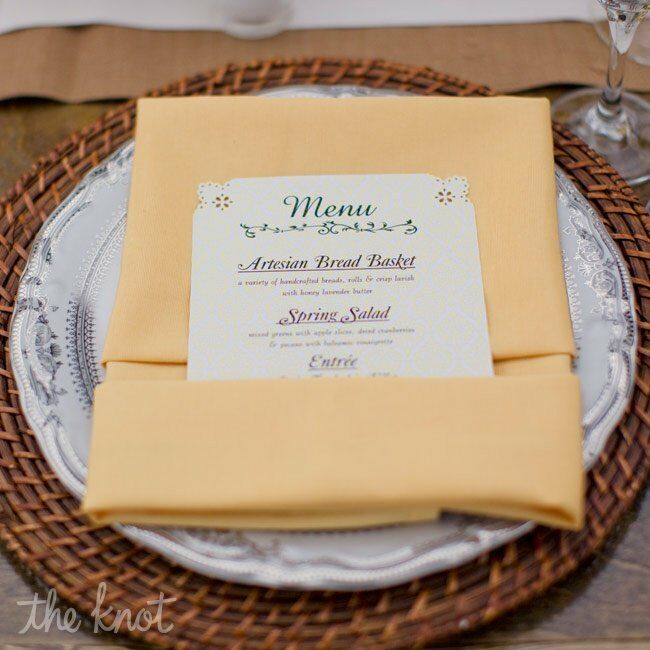 Silver plates dressed up the wicker chargers. Vintage-inspired menu cards were tucked into yellow napkins.