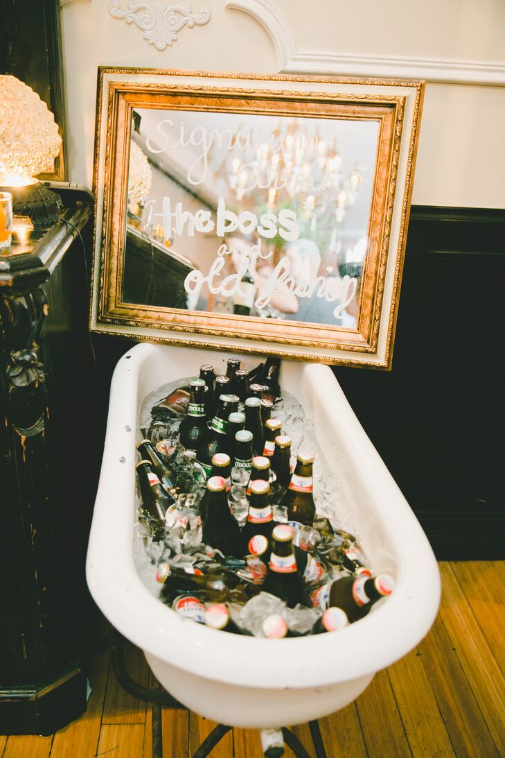 In keeping with the event's rustic, vintage theme, guests were offered cold beers from a porcelain tub just outside the  dining room at Carondelet House in Los Angeles, California.