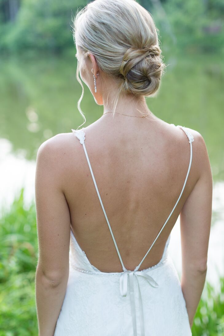 Natalia wore her hair in a loosely twisted bun at the nape of her neck.