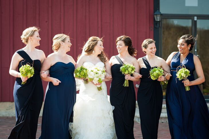 Since two of her bridesmaids were pregnant, Shannon let her bridesmaids choose their own gown, requesting only that they be long and in a shade of navy blue. Three of the women donned matching one-shoulder gowns with empire waist silhouettes, while the remaining two went with a strapless empire-style gown and a classic A-line style with a V-shaped neckline.