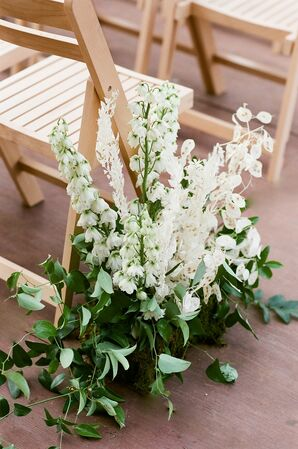 Romantic Aisle Decorations with White Delphiniums and Green Leaves