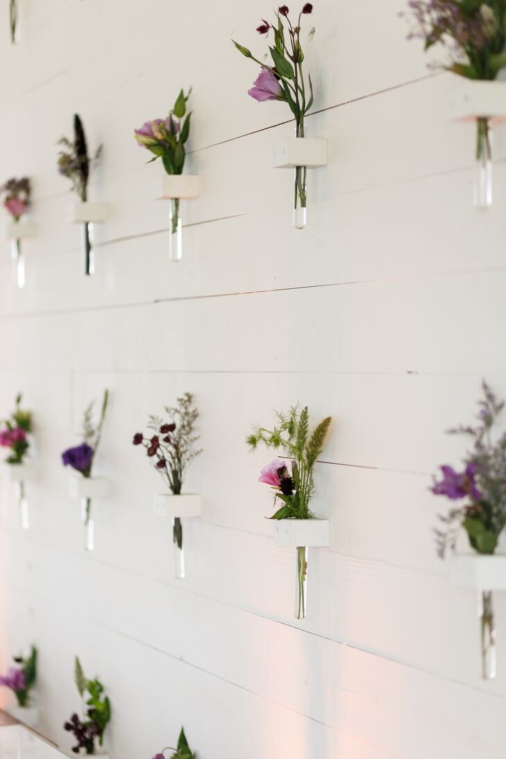 White Accent Wall with Purple Wildflower Installation