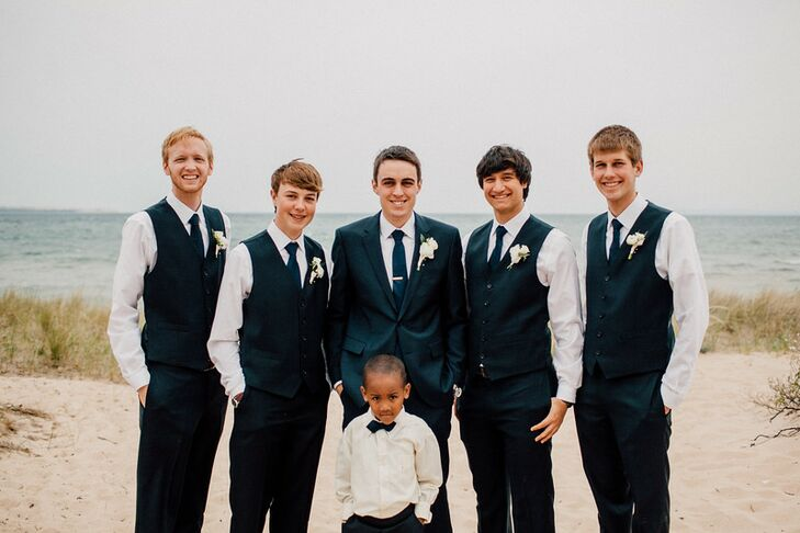 Austin wore a Hugo Boss suit with a Van Heusen tie; his groomsmen rented navy suits from Men's Wearhouse.