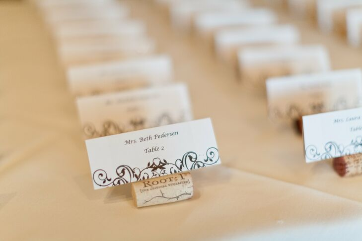The couple's vineyard theme came across in their escort cards, which were slated in wine corks.