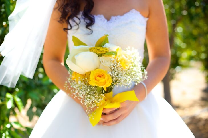 """The night before the wedding, my bridesmaids, family and I put together floral center pieces, boutonnières/bouquets and décor,"" says Vanessa. ""Each of my bridesmaids personally made there own unique bouquets. My bouquet consisted of yellow and white roses, eucalyptus, baby's breath and one large magnolia flower."""