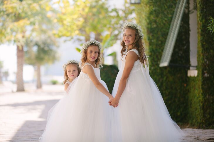 The flower girls wore a white handmade floor-length dress from Etsy. Each paired it with baby's breath flower crowns.