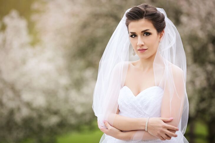 Bride With Crystal Drop Earrings and a Crystal Bracelet