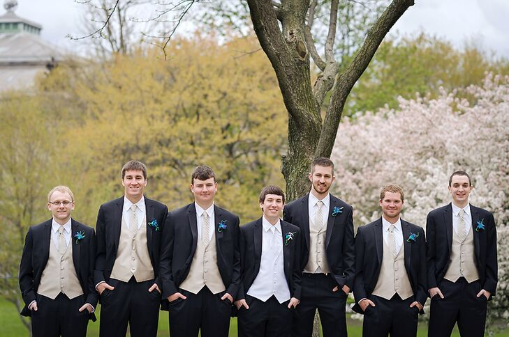 Groomsmen in Black Tuxedos With Pale Gold Vests and Ties