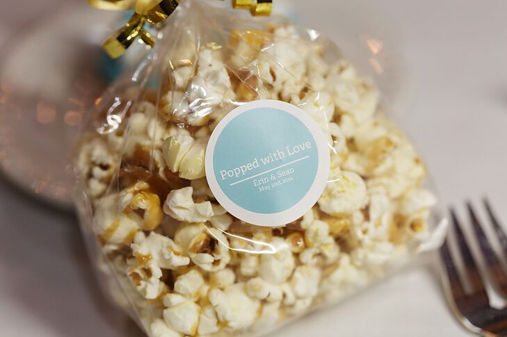 """The caramel popcorn favors were popped by Erin and her mother. The bags were labeled with a """"Popped with Love"""" tag and tied with a gold ribbon."""
