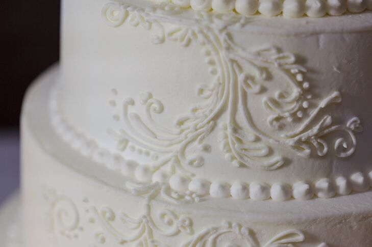 The three tier wedding cake was baked and decorated by Erin. The flavor was yellow cake with a lemon curd filling and buttercream frosting.