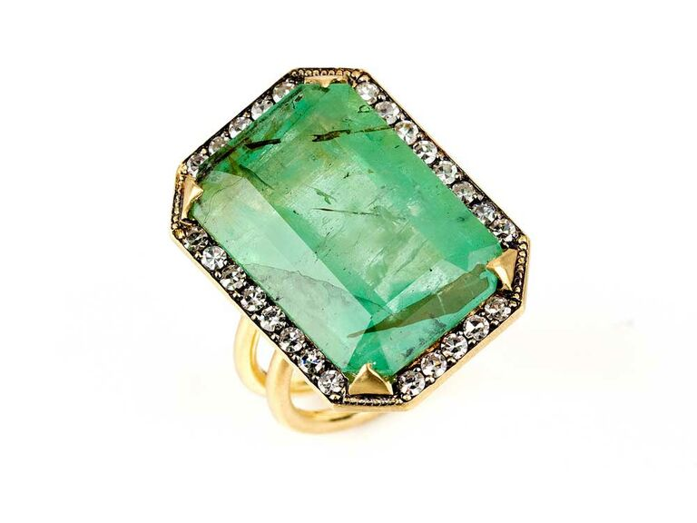 Emerald engagement ring with halo