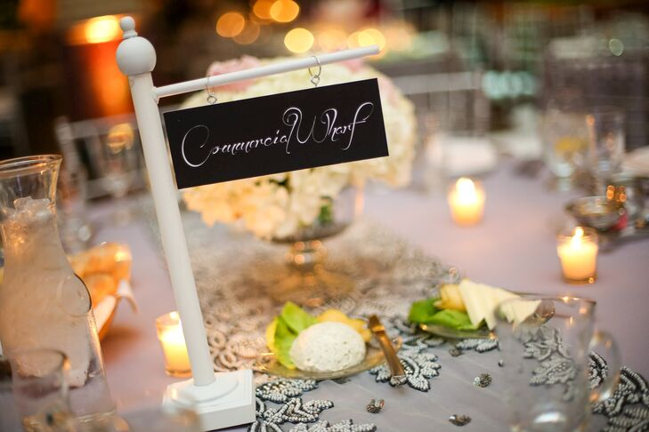 Wanting to give the wedding a touch of personal flair, Lindsay and John decided to make some of the décor elements themselves. For the table names, Lindsay enlisted the help of her sister to make small, old-fashioned street signs for each table. The signs bared the names of streets that had significant meaning to both her and John as individuals and as a couple, including the streets they had grown up on and that of the TD Garden, where they first met.