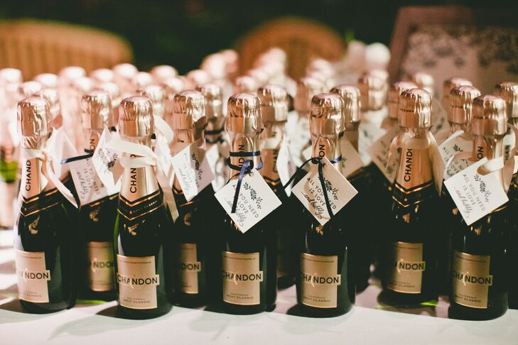 At the end of the night, Robyn and Tony sent their guests off with pint-sized bottles of Chandon champagne, which they dressed up with customized labels.