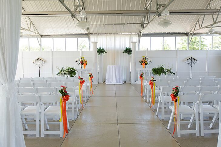 The ceremony venue was a glass atrium with white walls. Heather and Joey decorated the venue with orange ribbons and green bouquets that popped against the white background.