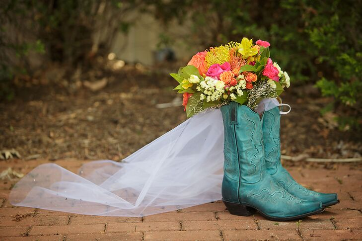 Instead of the traditional wedding heels, Heather opted for cool turquoise cowboy boots. Her bouquet consisted of bright pink and orange roses, proteas and lilies.