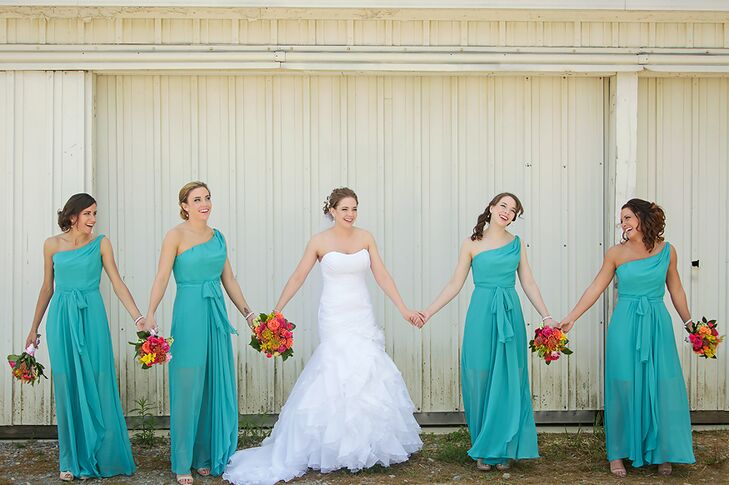 The bridesmaids wore one-shoulder, turquoise dresses by Jim Hjelm.