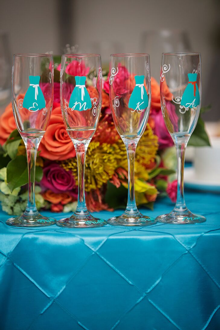 Heather gave her bridesmaids customized champagne flutes with turquoise dresses and their monograms printed on them.