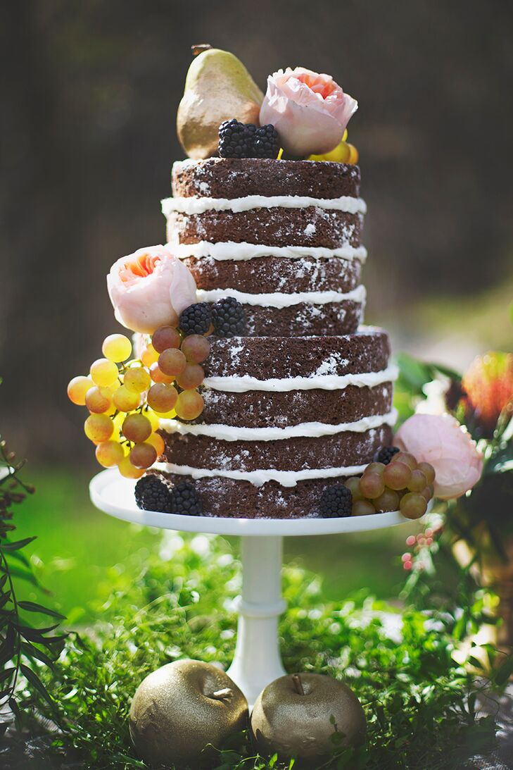A naked wedding cake, decked out with fresh fruit, brass pears and full garden roses was the perfect choice for the rustic, boho affair.