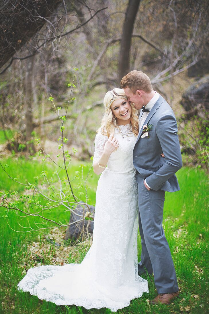 To reflect the wedding's bohemian, romantic vibe, the bride chose a classic lace, A-line dress with 3/4 length sleeves and a high neckline.  She wore her hair down in loose, romantic curls, completing the look with a gold headpiece.