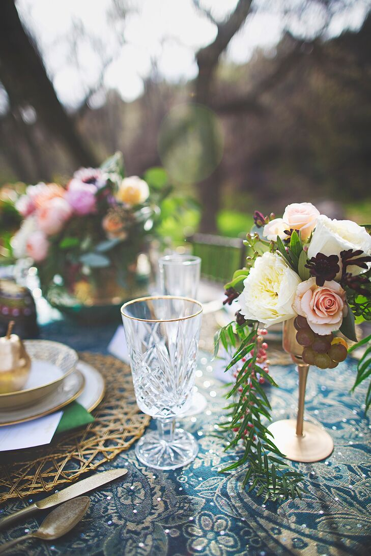 Bunches of lush, cascading blooms in delicate brass vases dotted the rhinestone-studded tablecloth, giving off a divine, celestial vibe.