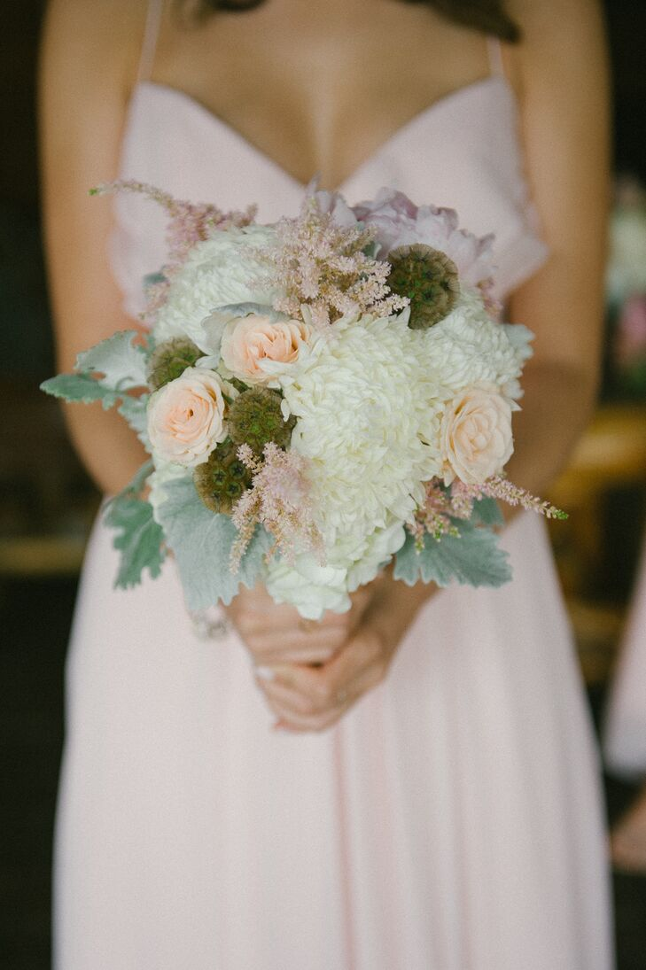The bridesmaids carried white spider mums, blush roses, pink astilbes, green scabiosa pods and mint dusty miller in their textured bouquets. Madeline loved the naturally gorgeous vistas of Spruce Mountain Ranch  in Larkspur, Colorado, and wanted the decor to go with it.