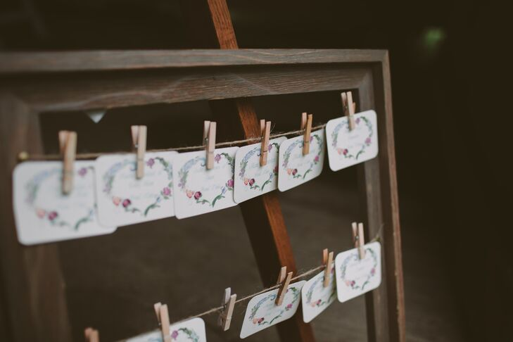 The escort cards featured a rosemaling border to tie in with the theme. They were displayed on clotheslines hung in a wooden frame.