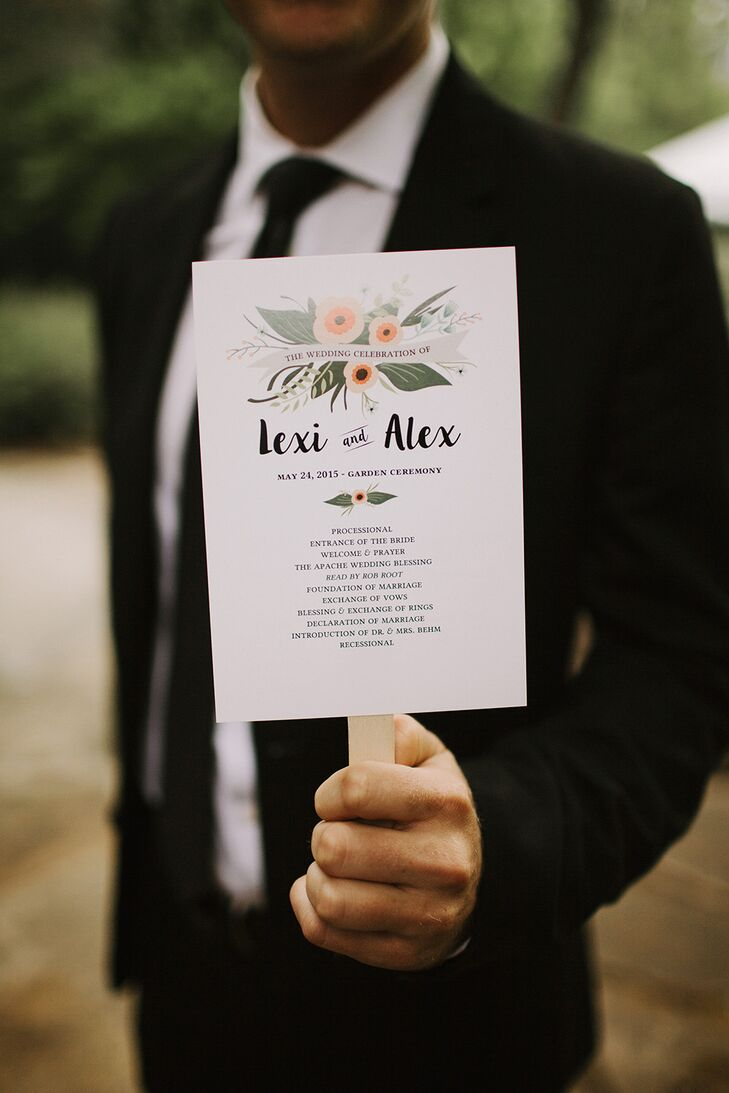 White ceremony programs held by sticks had a beautiful floral design at the top, reflecting the several blooms that filled the greenhouse for the reception.