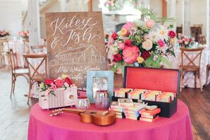 Table with Pink Linen, Wood Sign and 8-Track Favors