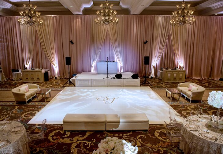 """As part of the branding of our wedding, we had a custom monogram made for us, an 'S & J.' This could be found on our invitations, menus, signs and more. It was also part of the focal point of the reception room: the dance floor,"" Sarah says. ""Our dance floor had a white vinyl wrap, and in the center was our monogram in metallic silver."""