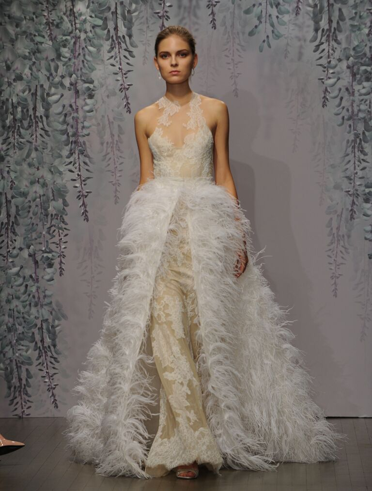 Monique Lhuillier Fall 2016 silk white/nude Chantilly and Re-embroidered lace racer illusion neckline sheath with criss-cross back and feather overskirt